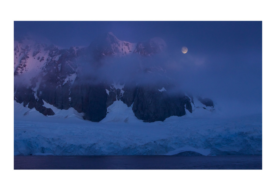 Photograph of Antarctic mountains and the moon.