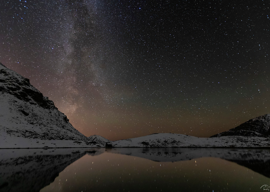 Milky Way and the afterglow of sunset over Summit Lake in Hatcher Pass in Sourthcentral Alaska. Autumn. Evening.