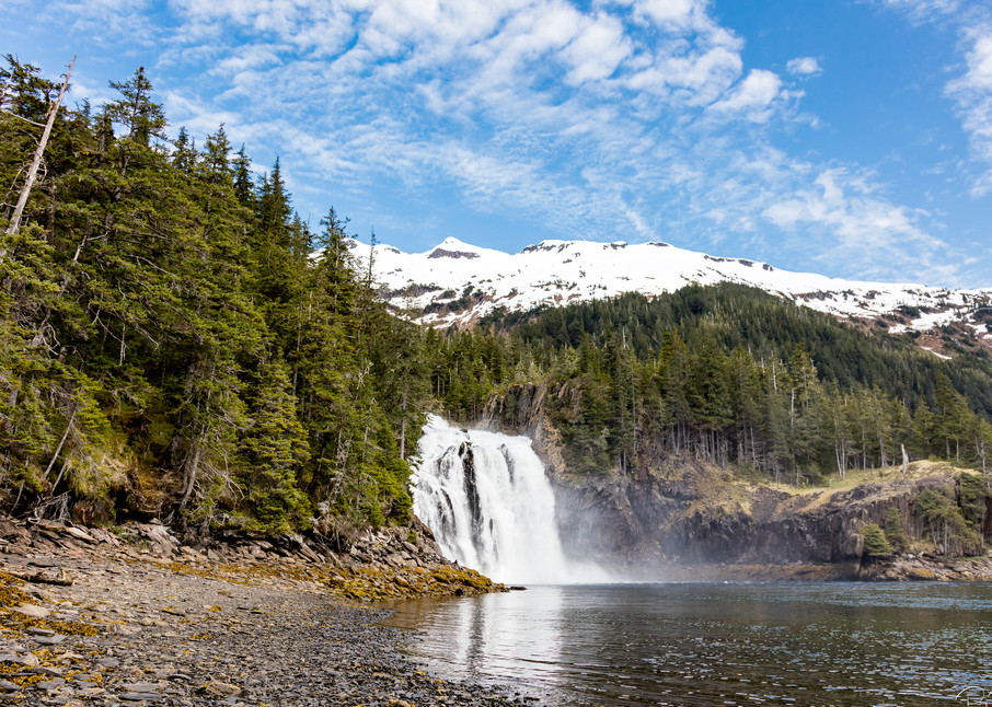 Large waterfall empties into Cascade Bay in Prince William Sound in Southcentral Alaska. Spring. Afternoon.