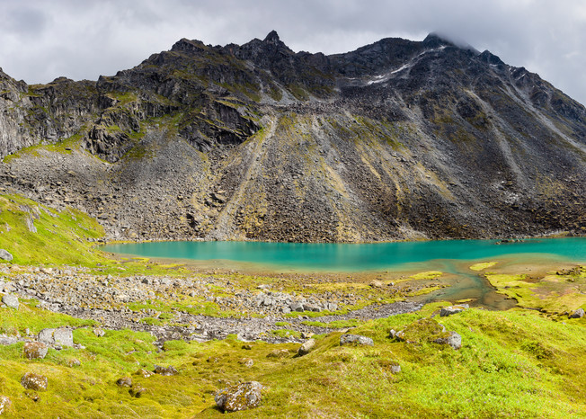 Composite panorama of Lower Reed Lake and Talkeetna Mountains from Reed Lakes Trail in Archangel Valley at Hatcher Pass in Southcentral Alaska. Summer. Afternoon.