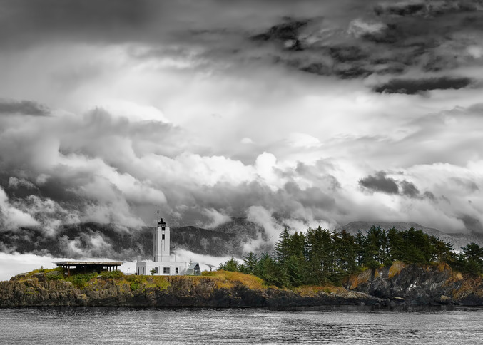 Fog and clouds highlight the need for The Five Finger Lighthouse in Stephens Passage in the Inside Passage of Southeast Alaska. Summer. Afternoon.