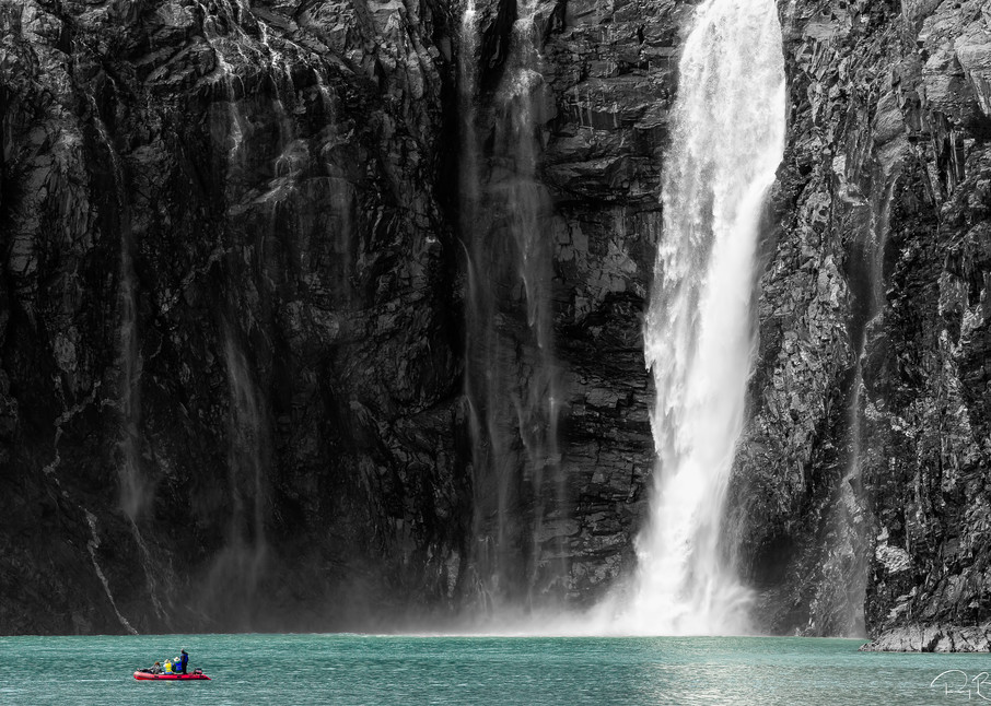 Rafters navigate along a waterfall from the Northland Glacier along Blackstone Bay near Whittier in Southcentral Alaska. Summer. Afternoon.