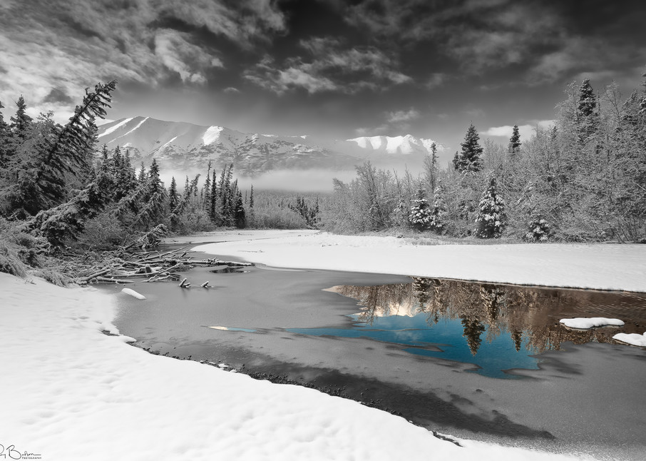 Morning light and early winter snow adorn the North Fork of Eagle River in Chugach State Park near Anchorage in Southcentral Alaska.
