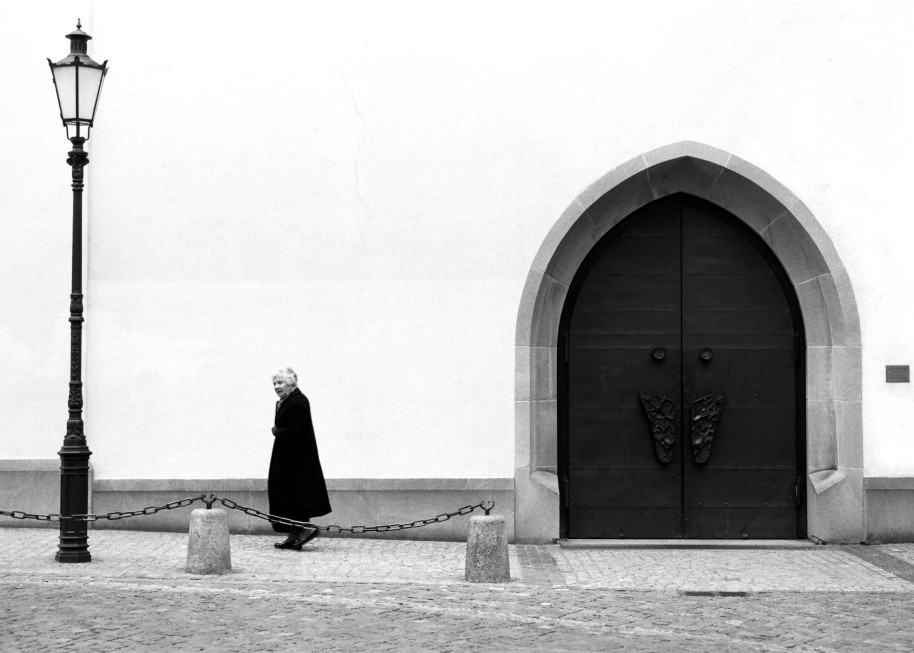 B&W Image of Elderly Lady In Front of Church, Zurich