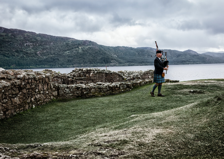 Scottish bagpiper at Urquhart Castle, Loch Ness, Scotland