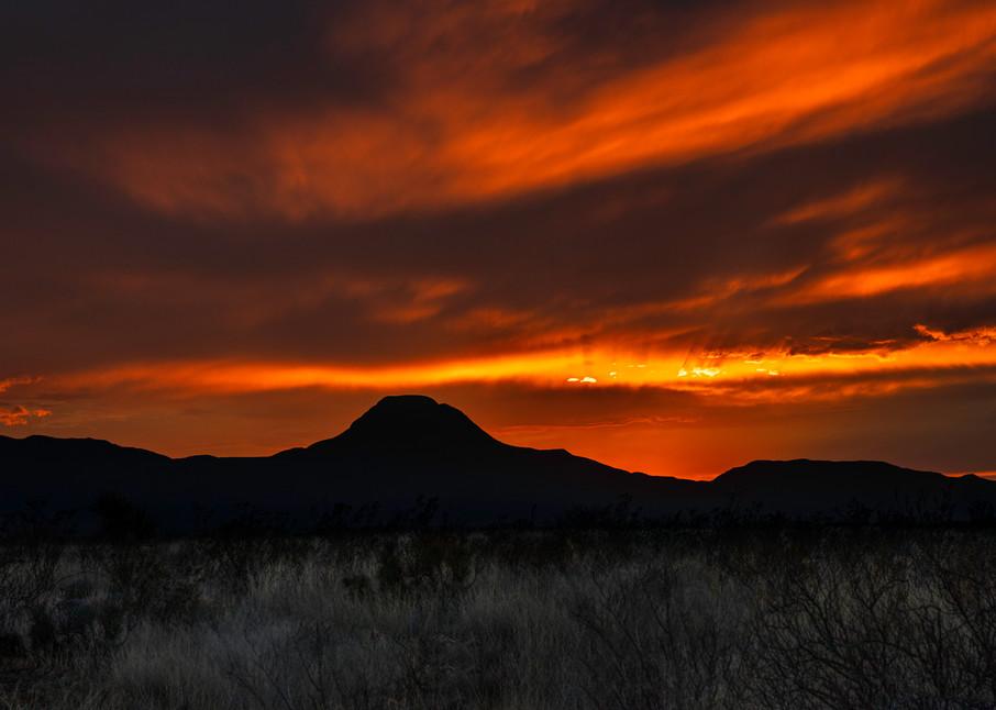 The sun setting behind Santiago Peak in southwest Texas
