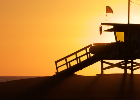 Lifeguard With Couple Silhouetted Photography Art | Michael Scott Adams Photography
