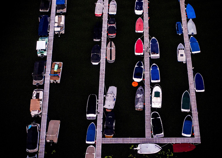 A dock full of colorful boats in Michigan