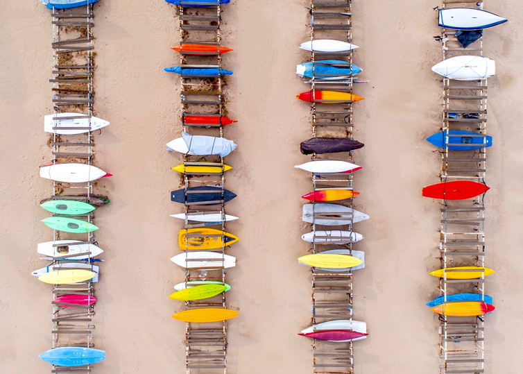 Kayaks and Row Boats on the Beach