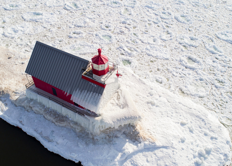Grand Haven lighthouse surrounded by ice pancakes.