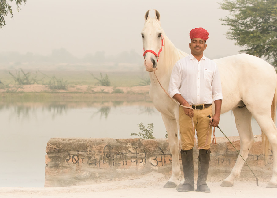 Horse Trainer poses with White Marwari Horse