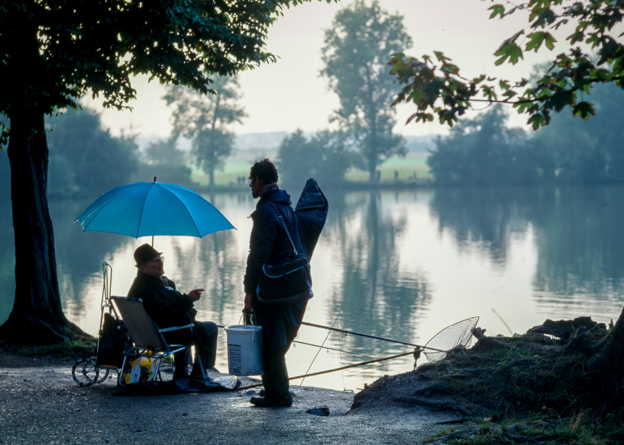Two fishermen at a lake on the grounds of a hotel near Stuttgart, Germany.