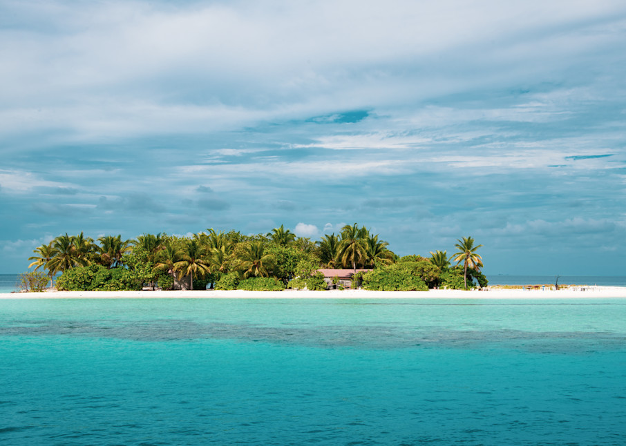 This fine art photograph of a tiny tropical island is available for sale.