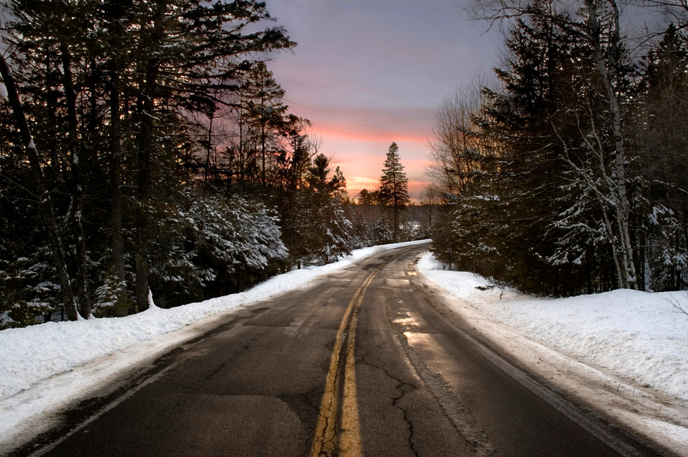 Sunset over a winter road