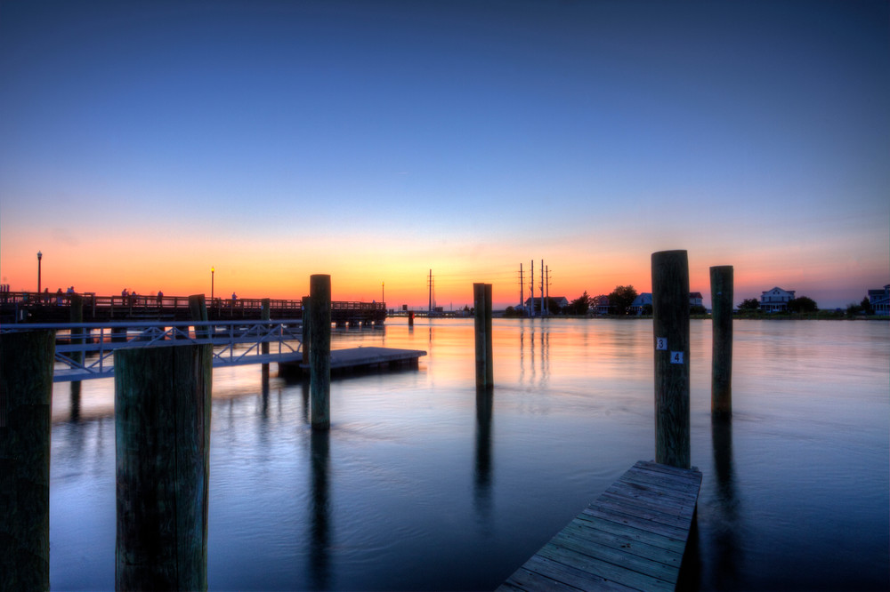 Piers In Chincoteague Fine Art Photograph by Michael Pucciarelli