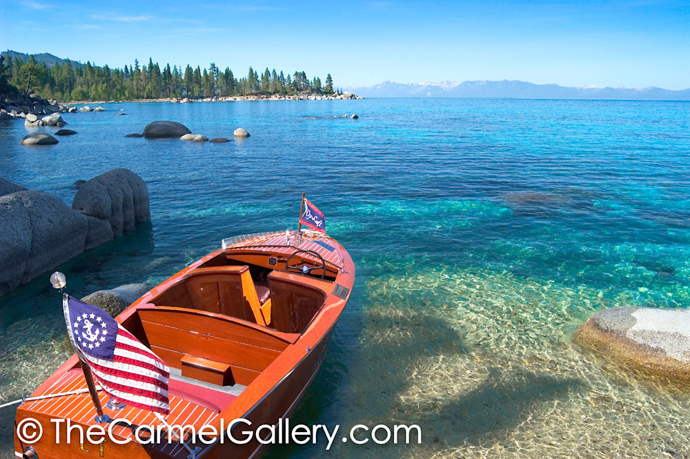 Old wooden boat with american flag at Lake Tahoe