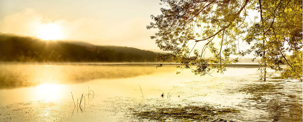 A golden sunrise on the peaceful Connecticut River
