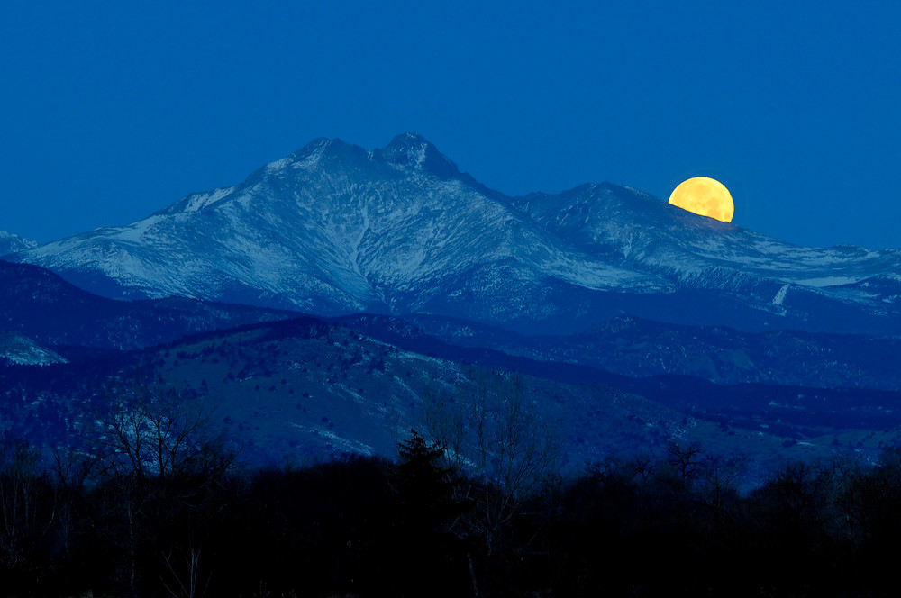 Setting moon behind the Rocky Mountains