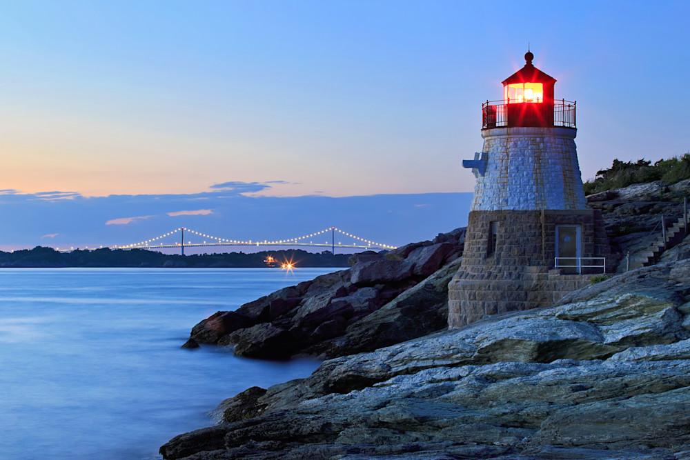 Fine art seascape photograph of the Castle Hill Lighthouse  and Newport Bridge in Newport, Rhode Island, at dusk on a summer evening.