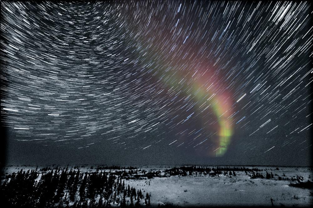 Aurora and Star Trails in a Snowy Landscape - Churchill, Manitoba, Canada 2013