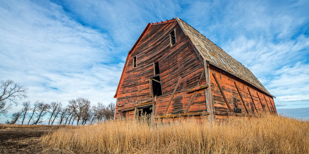 Spirit of Saskatchewan, this old red barn serves as a beacon of a time past in South East Saskatchewan. Available in a photograph print, canvas or printed on metal.