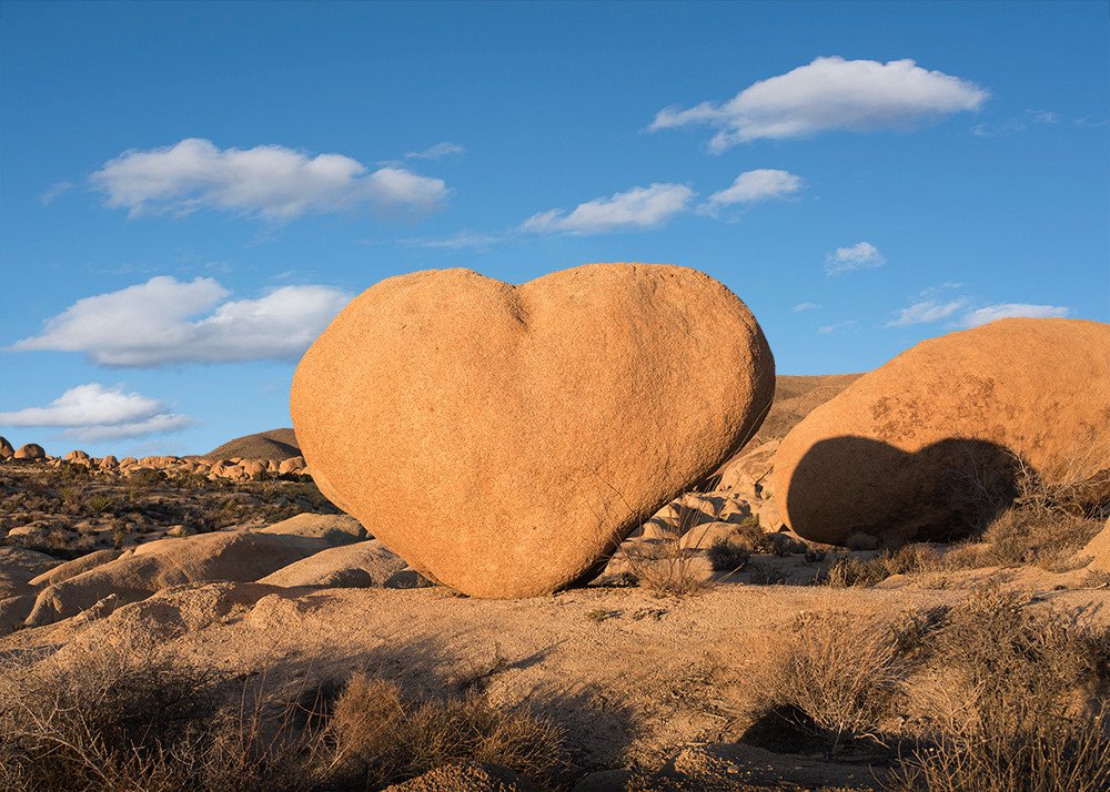 Spectacular color photo of heart rock and shadow in desert