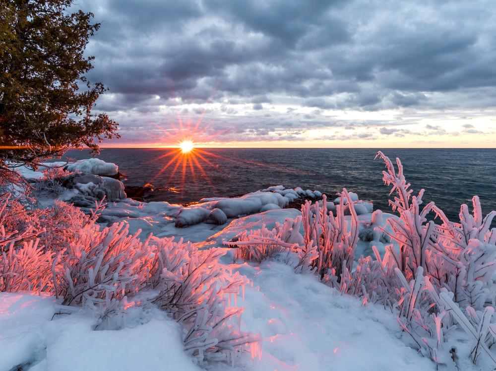 Ice covered shoreline at sunrise