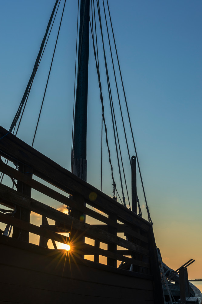 Silhouette of the Nina reproduction ship at sunrise Photographs – Fine Art Prints