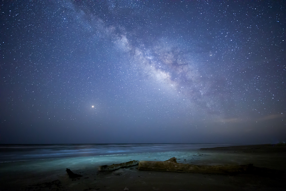 Illuminated surf with the Night sky above Photographs- Art prints