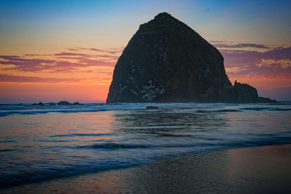 Sunset at Haystack Rock by Rick Berk