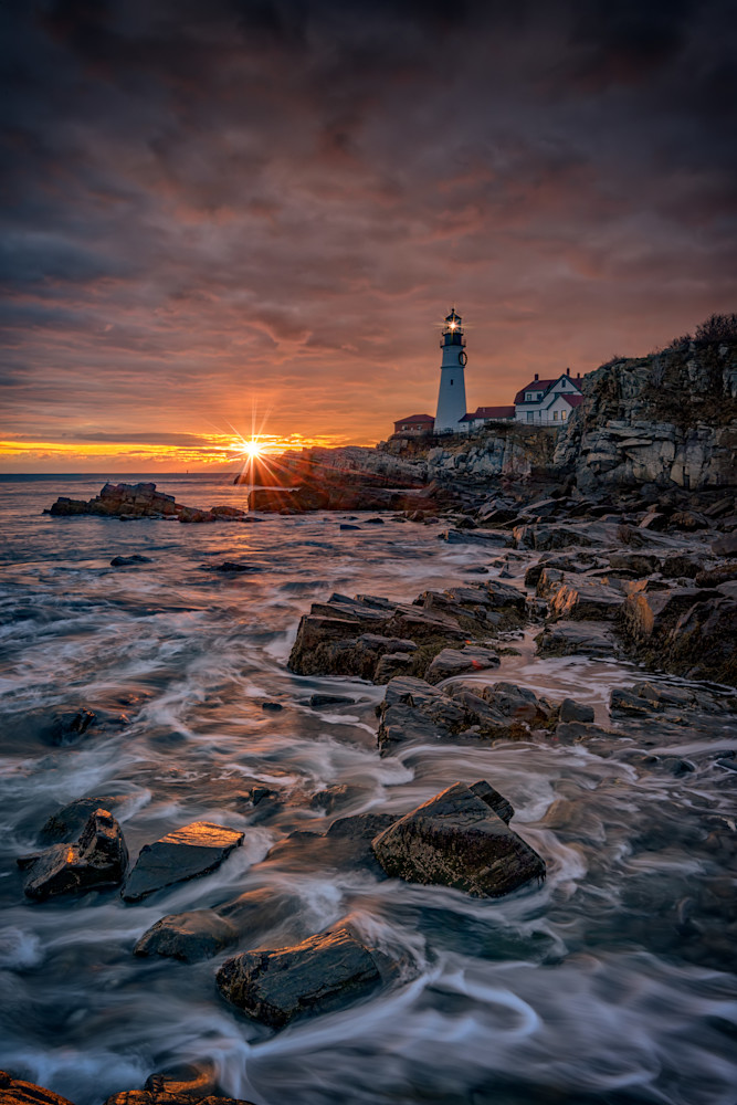 Shining Through at Portland Head Light by Rick Berk