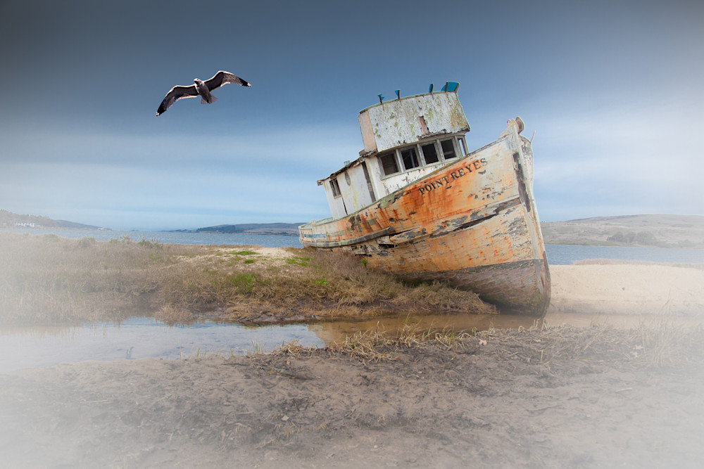 This old abandoned boat sits on the beach at Point Reyes, California. This old boat is often photographed by many photographers.