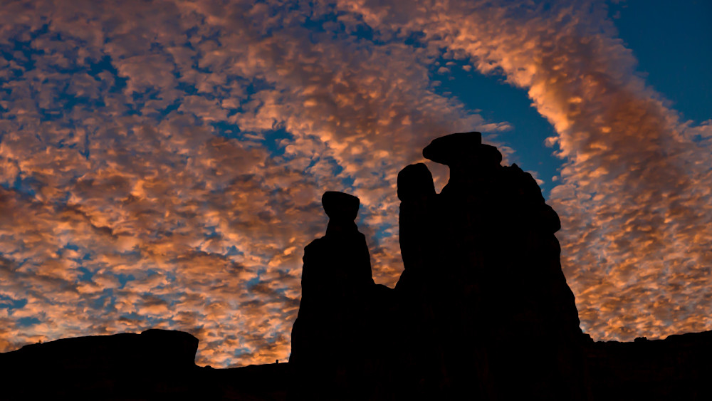 Three Gossips in Silhouette at Arches National Park.
