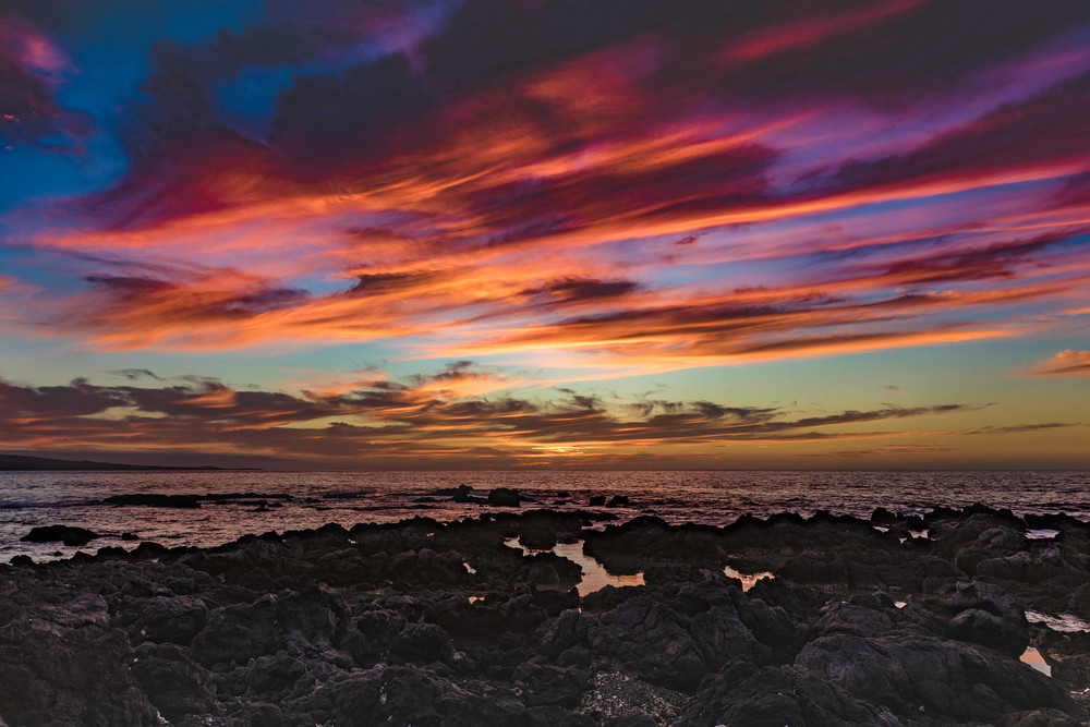 The shore pulls you Into the Sunset in this image from Hawaii.