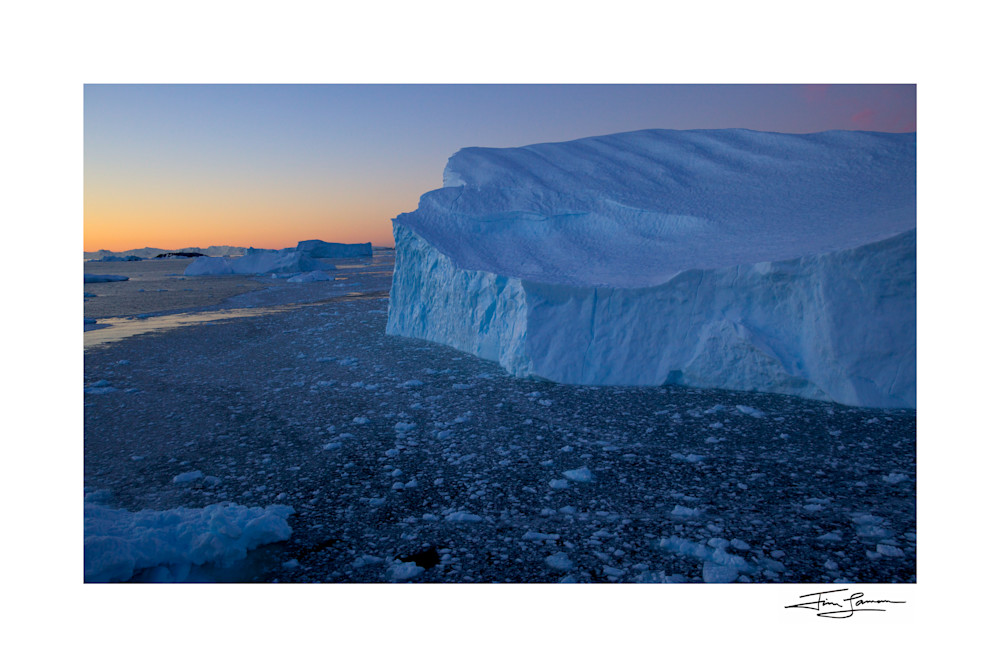 Photo of large iceberg in Cierva Cove, Antarctica, at dusk.