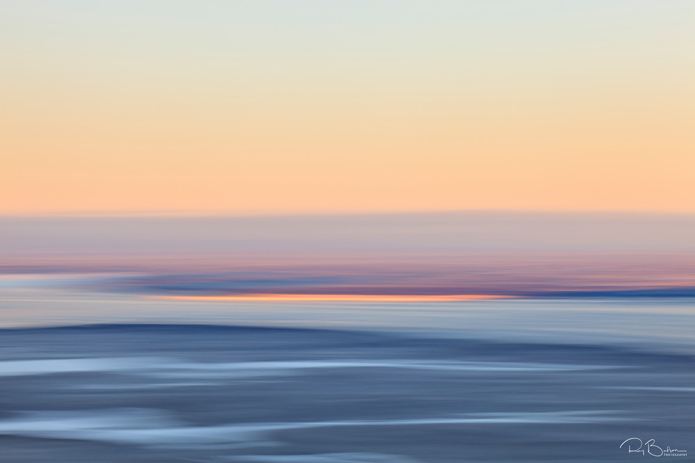 Motion blur of Eagle River Flats in foreground with snow covered lakes, Knik Arm, and Susitna Valley in background during sunrise from Eagle River in Southcentral Alaska. Winter. Morning.