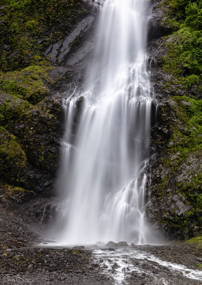 Long exposure of base of Bridal Veil Falls in Keystone Canyon near Valdez in Southcentral Alaska. Summer. Morning.