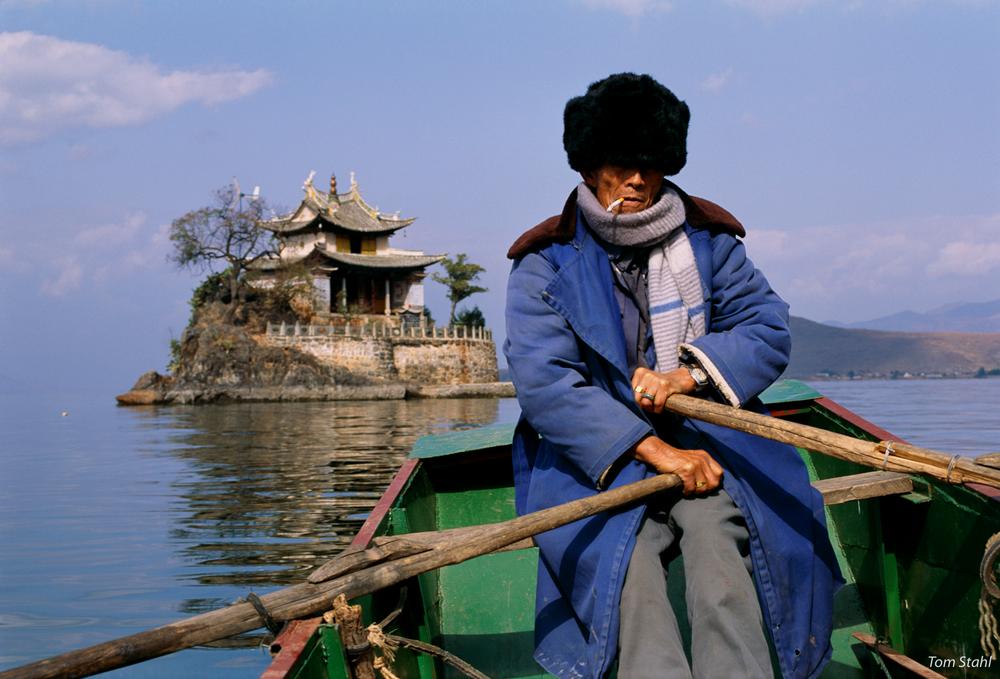 Rowing to temple, Dai Lake, China, 1992.