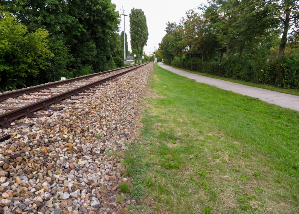 Rail tracks and path lead off into the distance
