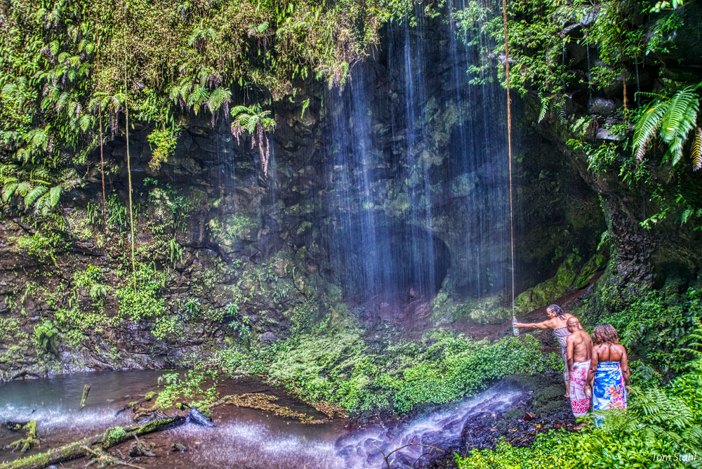 Collecting water at the Sacred Waterfall