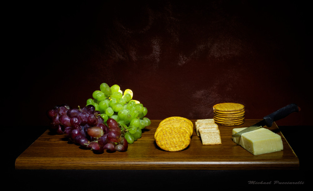 A Fine Art Photograph of European Fruit with Cheese and Crackers by Michael Pucciarelli