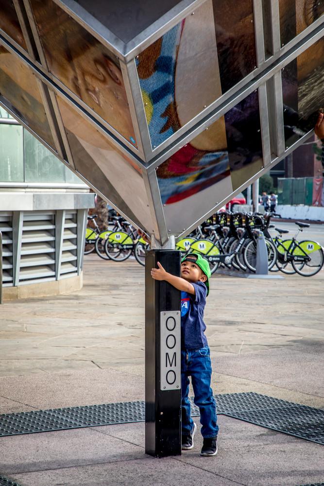 Boy Iin Green Cap Little Tokyo 2018 Photography Art | Dan Katz, Inc.