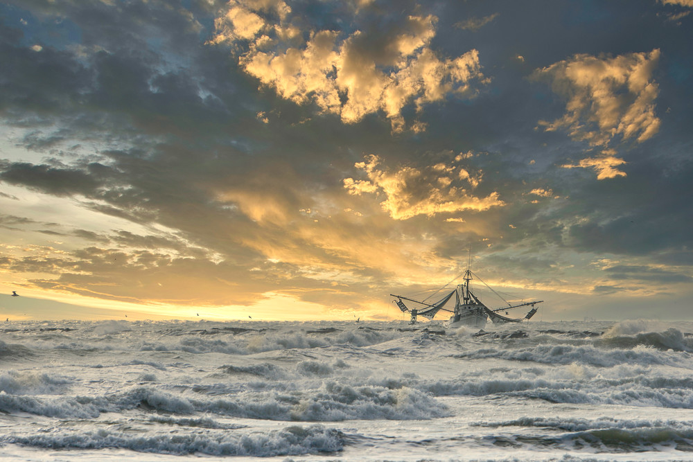 Photographing a shrimp boat coming in durning sunrise at South Padre Island Texas