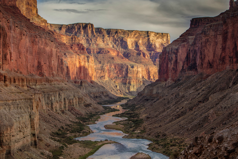 Standing above the Colorado River looking in Grand Canyon National Park at sunset