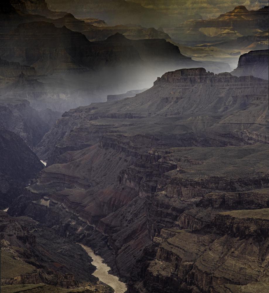 A passing storm drops a sheet of rain onto the Colorado River.