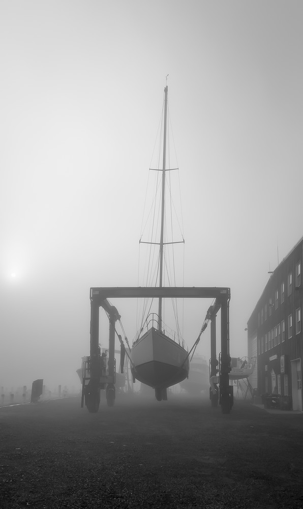 Sloop in Travel Lift at Dawn - Essex