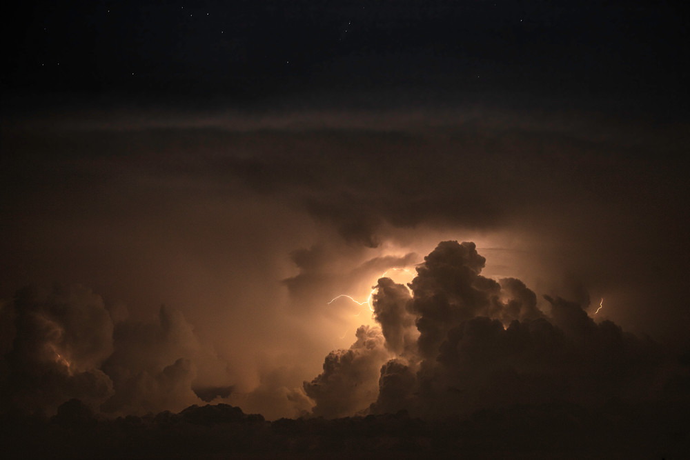 Photo of lightning in a building thunderstorm