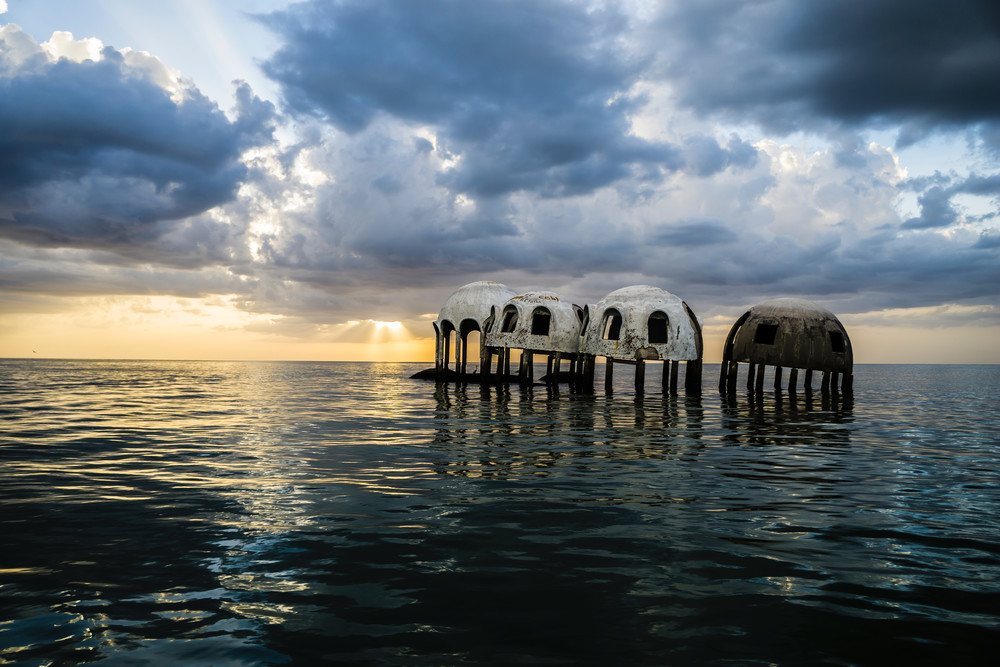 Cape Romano Sunset features the famous dome home, an abandoned structure slowly sinking into the Gulf of Mexico.