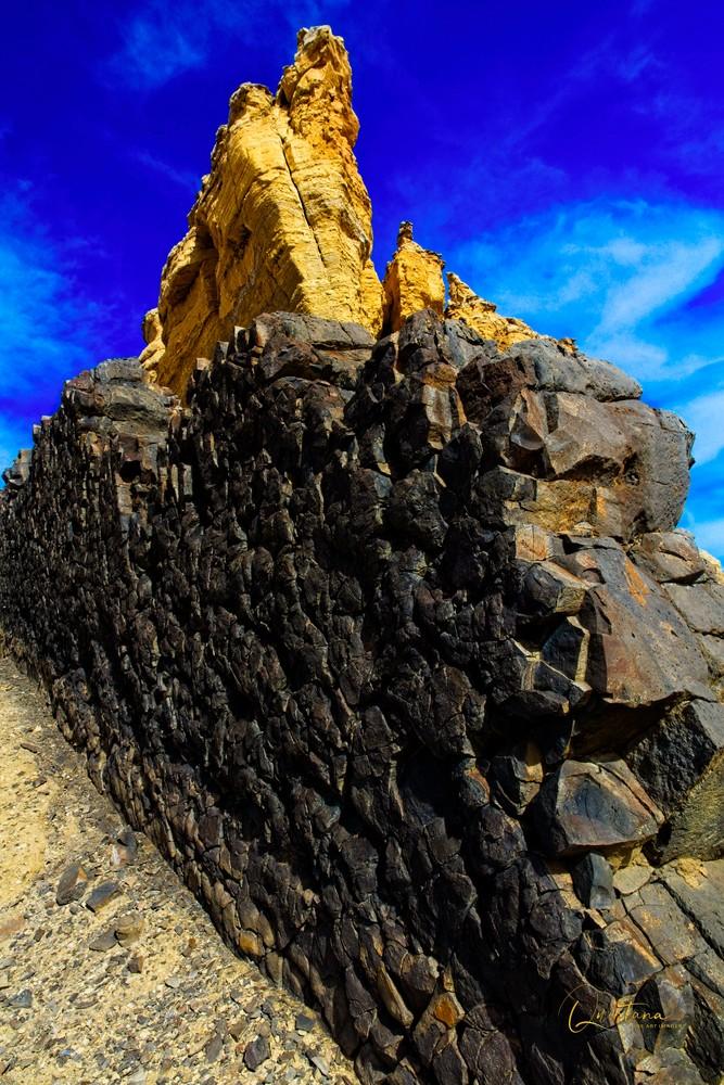 Lava Dike - A Fine Art Photograph by Marcos R. Quintana