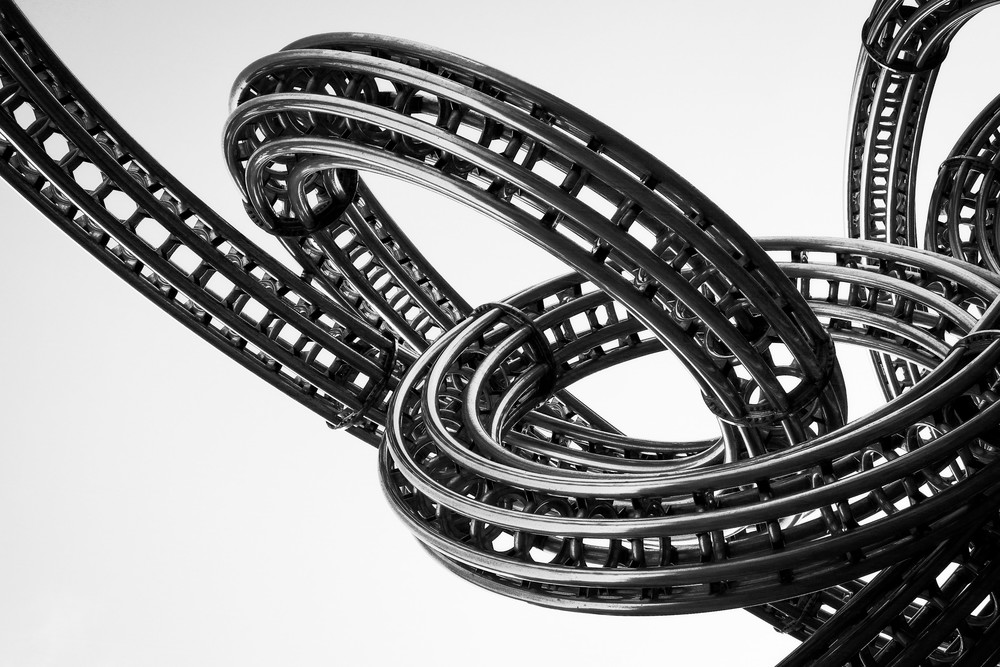 Black and White Photo of Curvy Sculpture